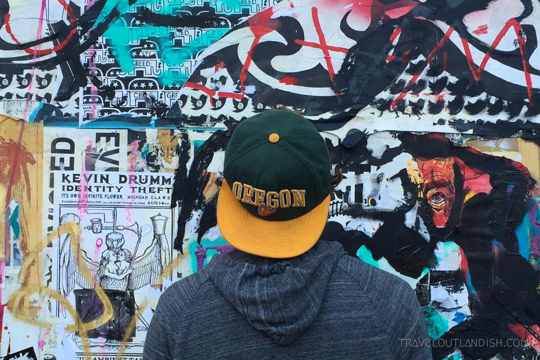 Daniel looking at Mission street art