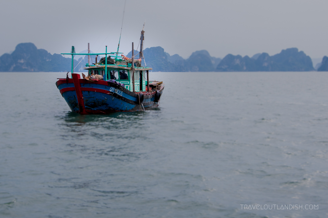 Bai Tu Long Bay - A fishing boat headed home