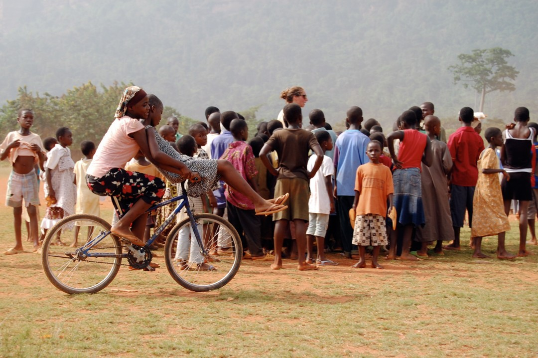 Ghana - Girls Riding a Bike