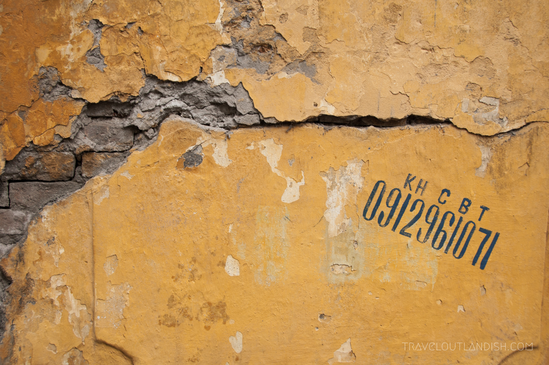 A Crack Going up a Yellow Wall