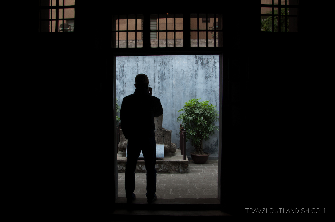 A Man Looking out at a Statue