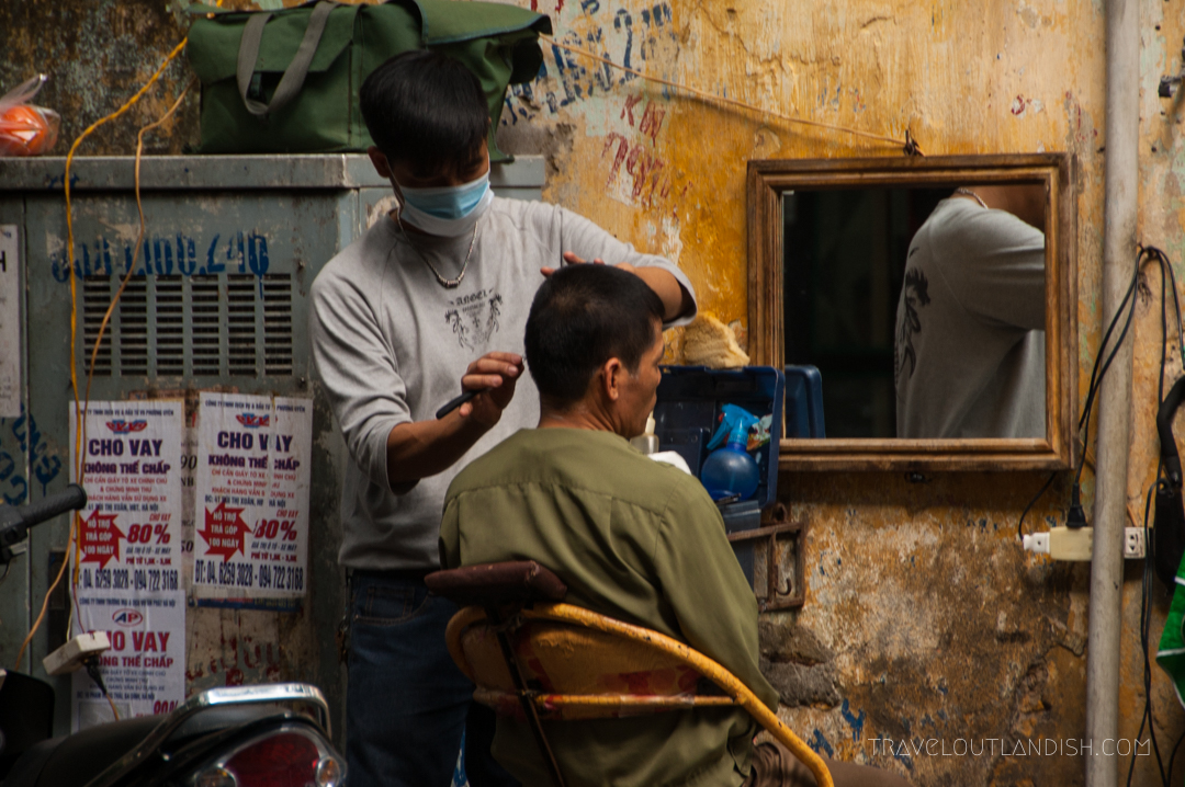 A Man Getting a Shave on the Corner