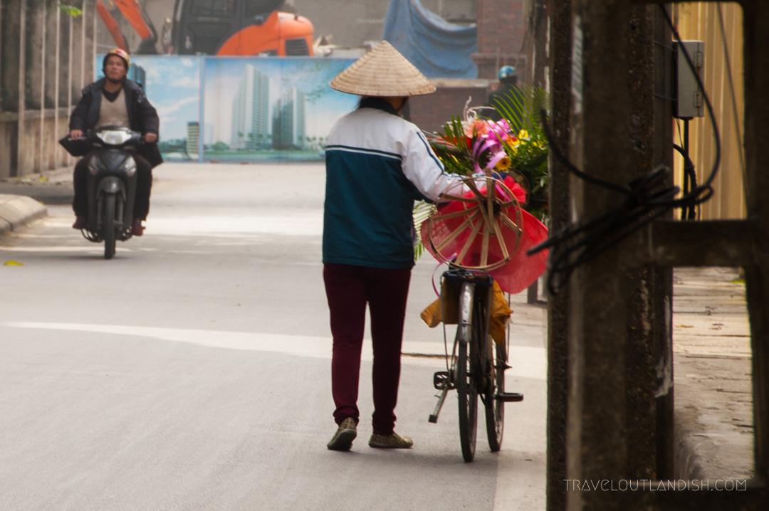Florist Walking her Bike of Flowers