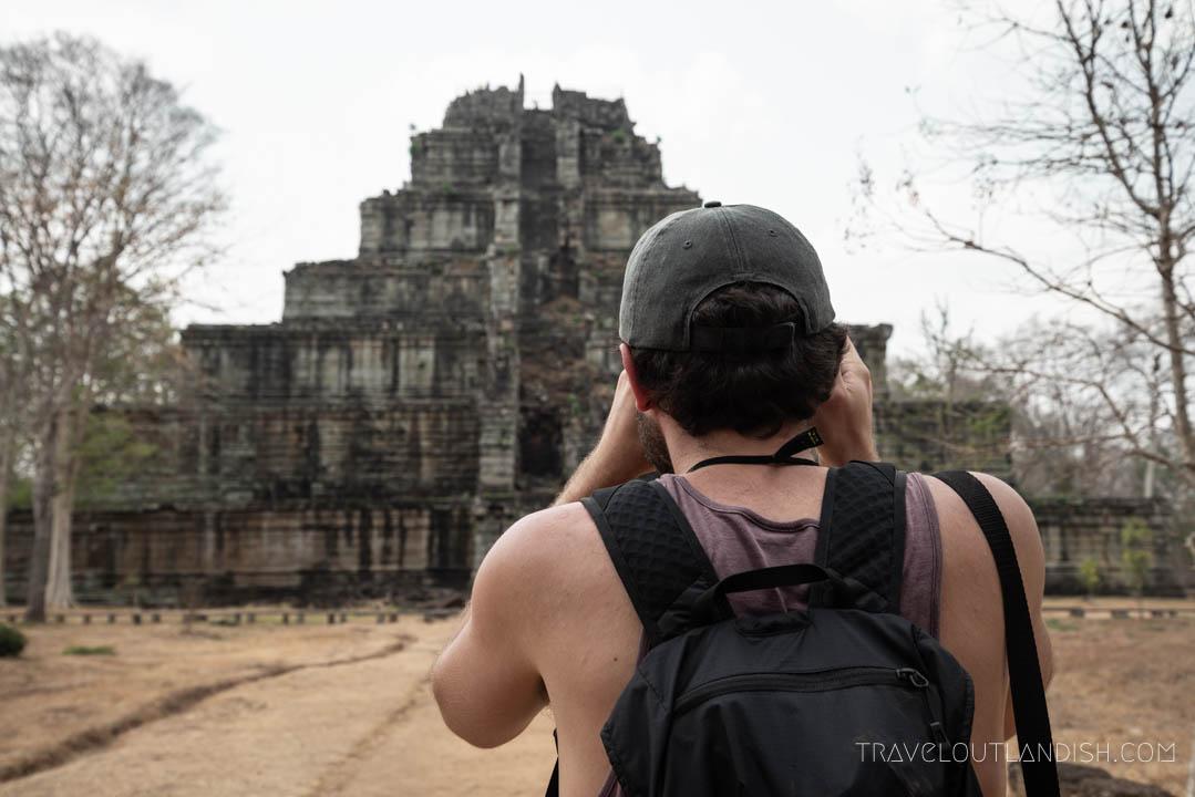 Man taking a photo at Koh Ker
